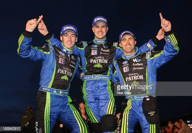 Simon Pagenaud of France Marino Franchiit of Scotland and David Brabham of Australia drivers of the Patron Highcroft Racing HPD celebrate their...