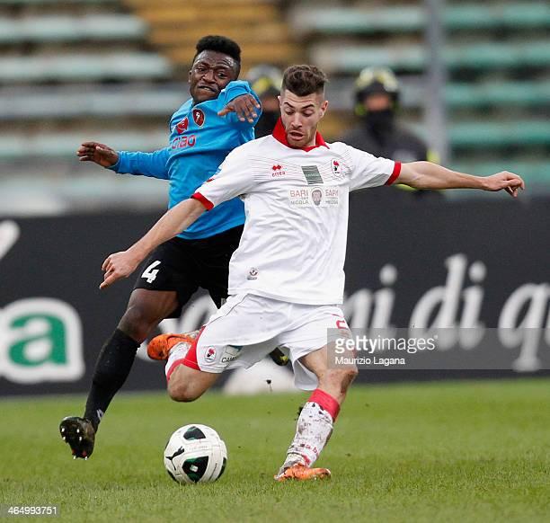 Simon Pambou of Reggina competes for the ball with Cristian Galano of Bari during the Serie B match between AS Bari and Reggina Calcio at Stadio San...