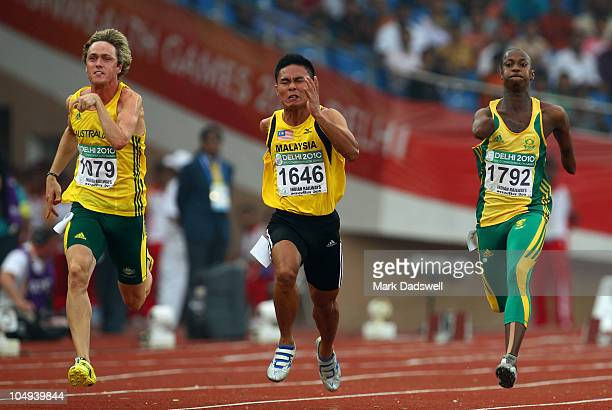 Simon Patmore of Auastralia Eryanto Bahtiar of Malaysia Smakelo Radebe of South Africa competes in the Men's T46 100 Metres semi final during day...