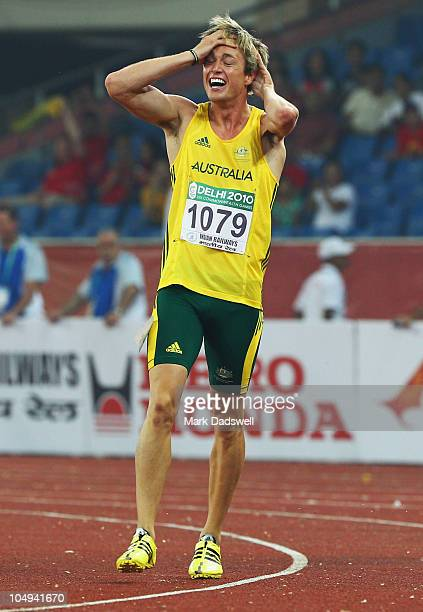 Simon Patmore of Australia celebrates after winning gold in the men's T46 100 metres final during day four of the Delhi 2010 Commonwealth Games at...