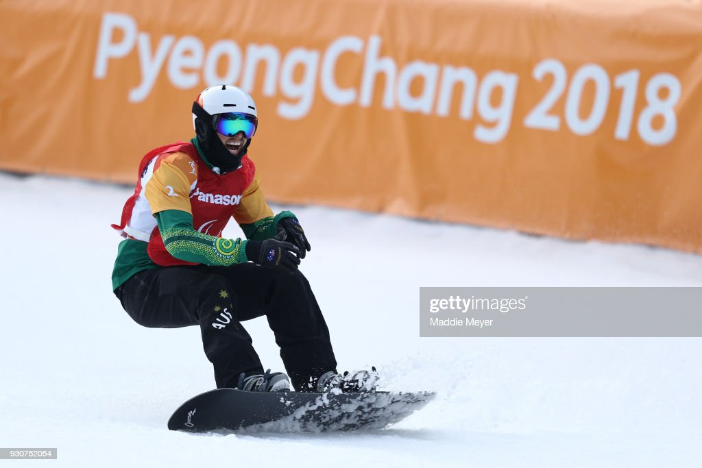 Simon Patmore of Australia celebrates winning the Gold medal in the Men's Snowboard Cross SB-UL during day three of the PyeongChang 2018 Paralympic Games on March 12, 2018 in Pyeongchang-gun, South Korea.