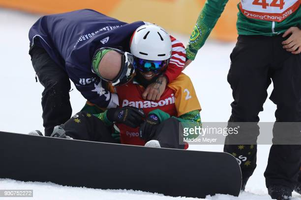 Simon Patmore of Australia celebrates winning the Gold medal in the Men's Snowboard Cross SBUL during day three of the PyeongChang 2018 Paralympic...