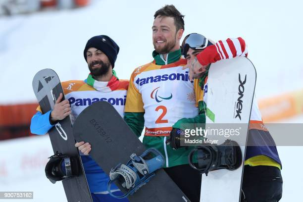 Simon Patmore of Australia celebrates winning the Gold medal with Silver medallist Manuel Pozzerle of Italy and Bronze medallist Mike Minor of USA in...