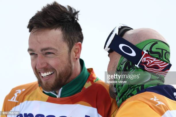 Simon Patmore of Australia celebrates with Bronze medallist Mike Minor of USA after winning the Gold medal in the Men's Snowboard Cross SBUL during...