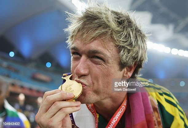 Simon Patmore of Australia celebrates with his gold medal after winning the men's T46 100 metres final during day four of the Delhi 2010 Commonwealth...