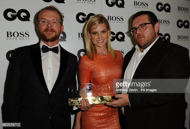 Simon Pegg and Nick Frost winners of Comedians awards pose with Alice Eve backstage at the GQ Men of the Year Awards in association with Hugo Boss at...