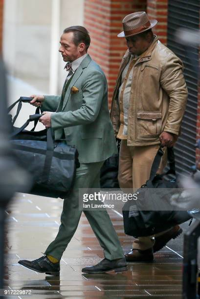 Simon Pegg and Ving Rhames seen filming scenes for Mission Impossible 6 at the Tate Moderm museum on February 11 2018 in London England