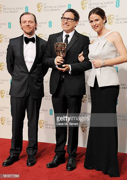 Simon Pegg Best Adapted Screenplay winner David O Russell and Jennifer Garner pose in the Press Room at the EE British Academy Film Awards at The...
