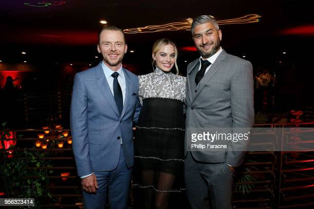 Simon Pegg Margot Robbie and Vaughn Stein attend the after party for the premiere of RLJE Films' Terminal at The Escape Room on May 8 2018 in...