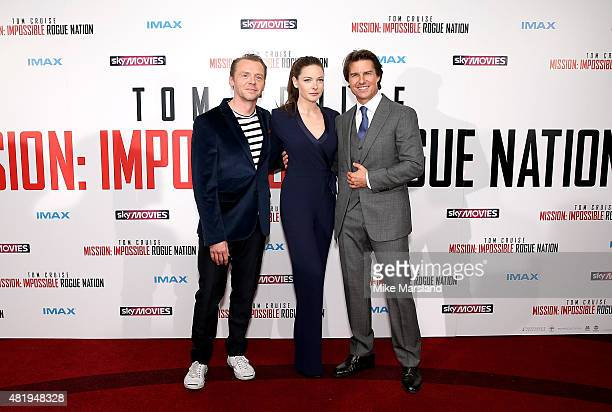 Simon Pegg Rebecca Ferguson and Tom Cruise attend the UK Fan Screening of 'Mission Impossible Rogue Nation' at the IMAX Waterloo on July 25 2015 in...