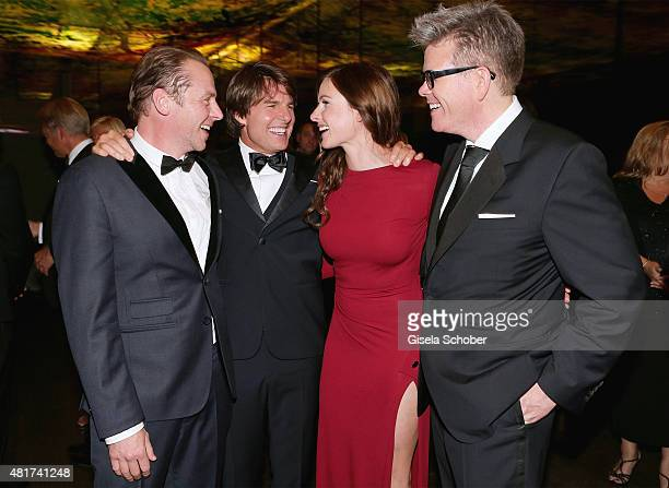 Simon Pegg Tom Cruise Rebecca Ferguson and Director Christopher McQuarrie attend the afterparty for the world premiere of 'Mission Impossible Rogue...