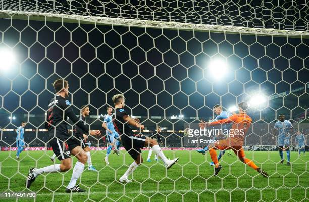 Simon Piesinger of Randers FC scores the 1-0 goal against Goalkeeper Jesper Hansen of FC Midtjylland during the Danish 3F Superliga match between FC...