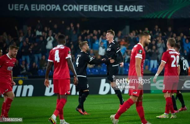 Simon Piesinger of Randers FC scores the 1-1 goal against Goalkeeper Peter Vindahl-Jensen of AZ Alkmaar during the UEFA Conference League match...
