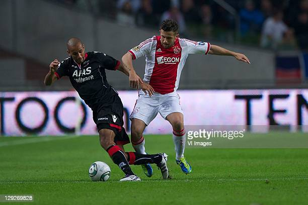 Simon Poulsen of AZ,Miralem Sulejmani of Ajax during the Eredivisie match between Ajax and AZ at the Amsterdam Arena on October 15, 2011 in...