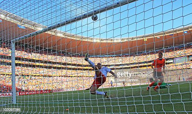 Simon Poulsen of Denmark clears the ball off the line during the 2010 FIFA World Cup Group E match between Netherlands and Denmark at Soccer City...