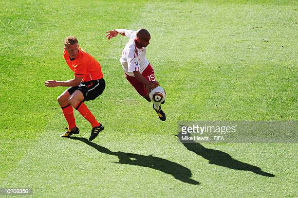 Simon Poulsen of Denmark is challenged by Dirk Kuyt of the Netherlands during the 2010 FIFA World Cup Group E match between Netherlands and Denmark...