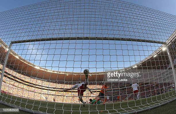 Simon Poulsen of Denmark makes up for scoring an own goal and makes a wonderful goalline clearance during the 2010 FIFA World Cup Group E match...