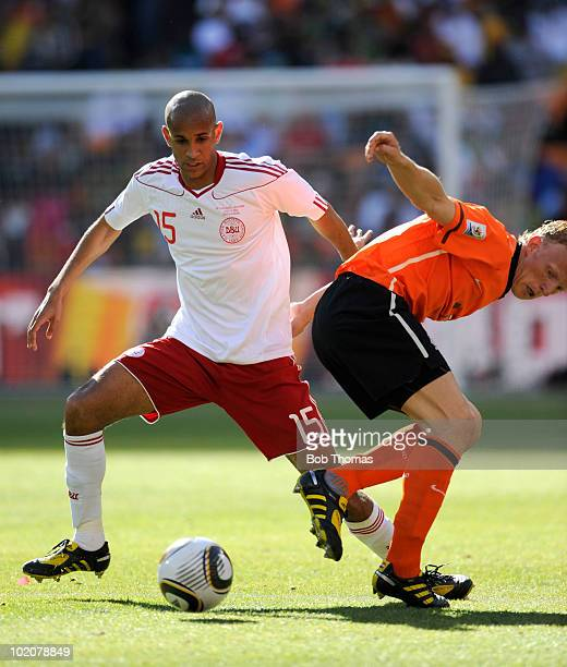 Simon Poulsen of Denmark with Dirk Kuyt of the Netherlands during the 2010 FIFA World Cup Group E match between Netherlands and Denmark at Soccer...