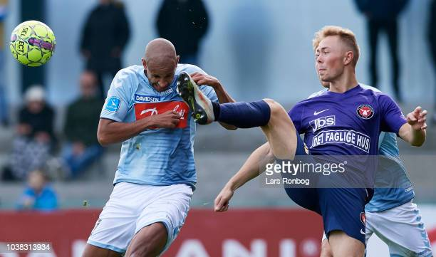 Simon Poulsen of Sonderjyske and Joel Andersson of FC Midtjylland compete for the ball during the Danish Superliga match between Sonderjyske and FC...