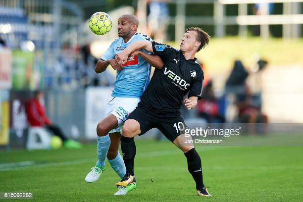Simon Poulsen of SonderjyskE and Marvin Pourié compete for the ball during the Danish Alka Superliga match between SonderjyskE and Randers FC at...