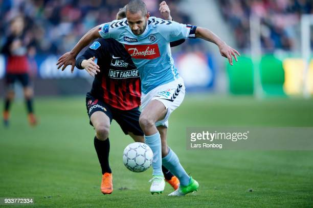 Simon Poulsen of Sonderjyske controls the ball during the Danish Alka Superliga match between FC Midtjylland and Sonderjyske at MCH Arena on March...