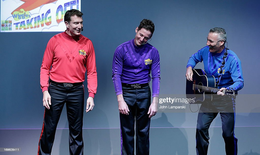 Simon Pryce, Lachlan Gillespie and Anthony Field of the Wiggles perform at the Apple Store Soho on May 12, 2013 in New York City.