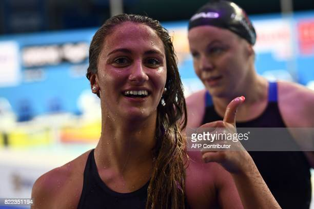 Simon Quadrella celebrates a new world record after the women's 100m backstroke final during the swimming competition at the 2017 FINA World...