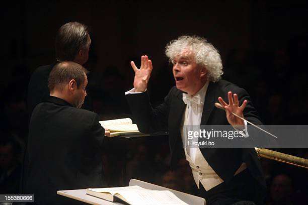 Simon Rattle leading the Philadelphia Orchestra in Berlioz's La damnation de Faust at Carnegie Hall on Friday night May 1 2009This imageFrom front to...