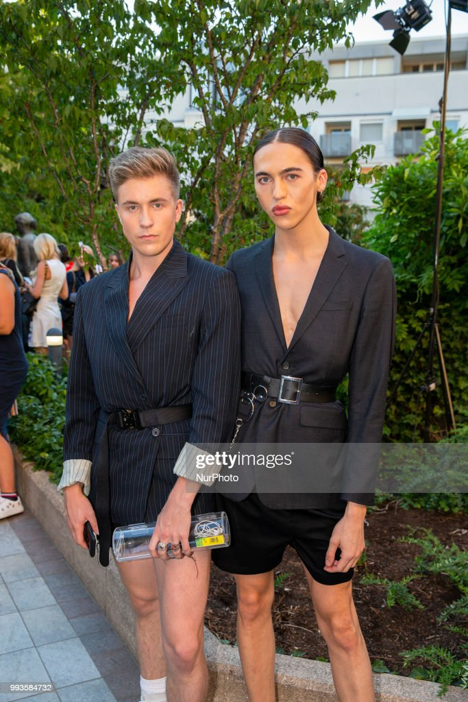 Simon Rechenauer (R) and guest attend the Marcel Ostertag Fashion Show during the Berlin Fashion Week Spring/Summer 2019 in Berlin, Germany on July 4, 2018.