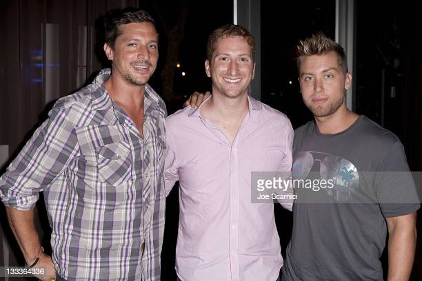 Simon Rex Guy Shalem Lance Bass pose for a photo before the pilot goes on at O Bar Restaurant and Lounge on August 5 2009 in West Hollywood California