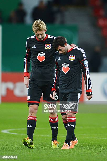 Simon Rolfes and Gonzalo Castro of Bayer Leverkusen look dejected after the DFB Cup quarterfinal match between Bayer Leverkusen and 1 FC...
