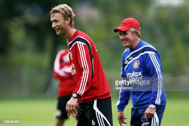 Simon Rolfes and head coach Jupp Heynckes laugh during the training camp of Bayer 04 Leverkusen at the training ground Gruendenmoos on July 26 2010...