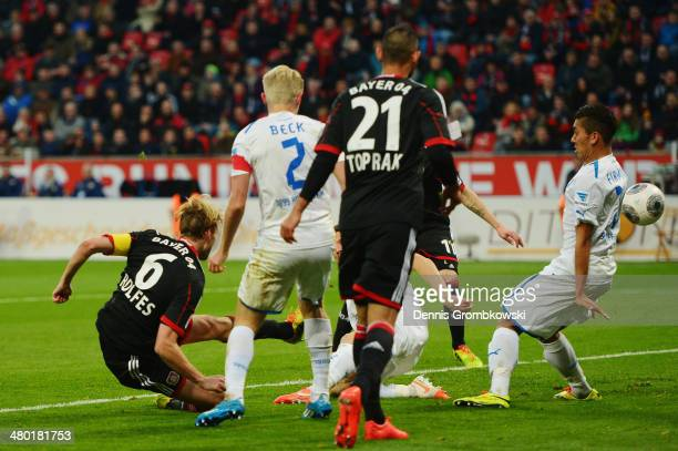 Simon Rolfes of Bayer Leverkusen scores his team's second goal during the Bundesliga match between Bayer Leverkusen and 1899 Hoffenheim at BayArena...