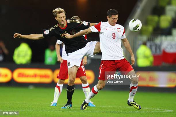 Simon Rolfes of Germany is challenged by Robert Lewandowski of Poland during the International friendly match between Poland and Germany at PGE Arena...