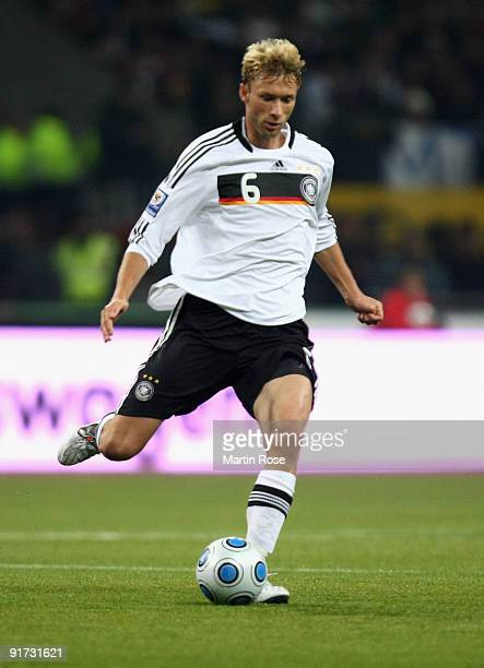 Simon Rolfes of Germany runs with the ball during the FIFA 2010 World Cup Group 4 Qualifier match between Russia and Germany at the Luzhniki Stadium...
