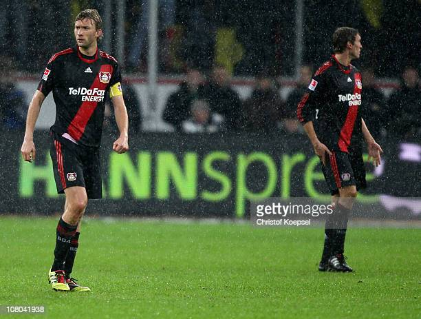 Simon Rolfes of Leverkusen and Stefan Reinartz of Leverkusen look dejected after the thrid goal of Dortmund during the Bundesliga match between Bayer...