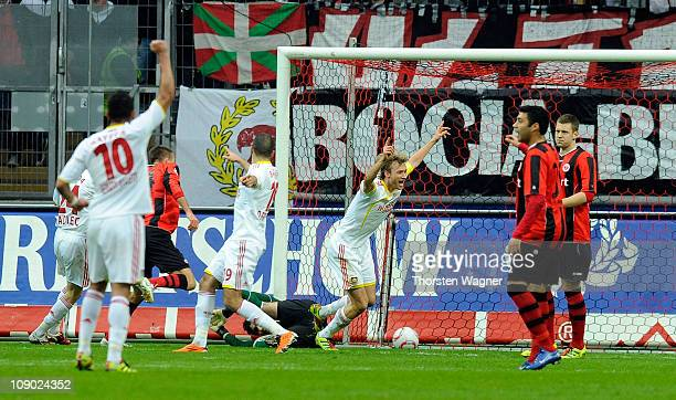 Simon Rolfes of Leverkusen celebrates after scoring his teams first goal during the Bundesliga match between Eintracht Frankfurt and Bayer 04...