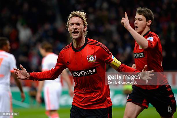 Simon Rolfes of Leverkusen celebrates after scoring his team's first goal during the Bundesliga match between Bayer 04 Leverkusen and FC Bayern...