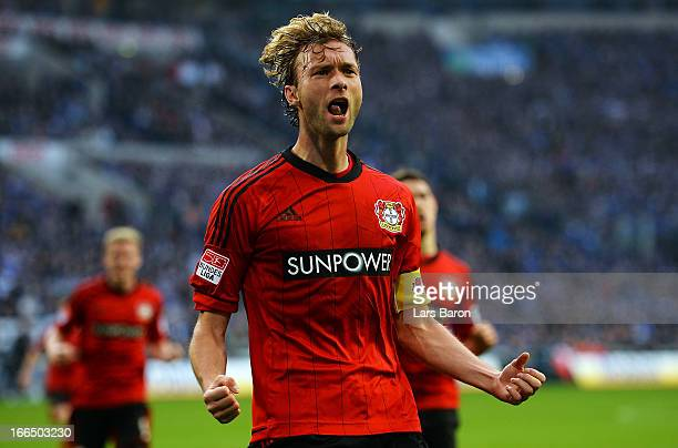 Simon Rolfes of Leverkusen celebrates after scoring his teams first goal during the Bundesliga match between FC Schalke 04 and Bayer 04 Leverkusen at...