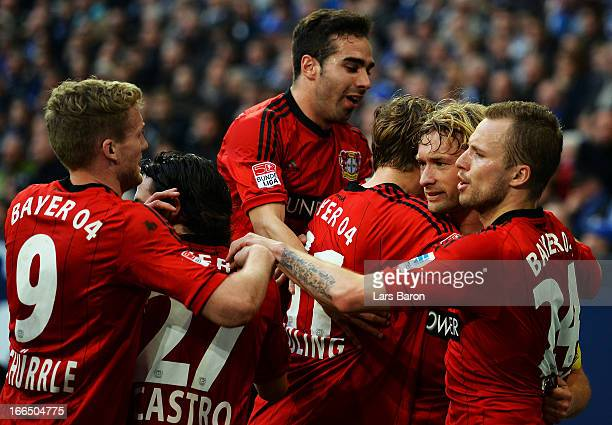 Simon Rolfes of Leverkusen celebrates with team mates after scoring his teams first goal during the Bundesliga match between FC Schalke 04 and Bayer...