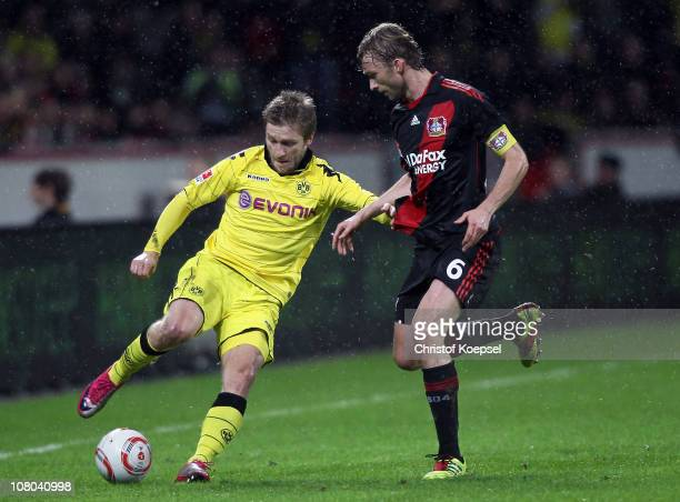 Simon Rolfes of Leverkusen challenges Jakub Blaszczykowski of Dortmund during the Bundesliga match between Bayer Leverkusen and Borussia Dortmund at...