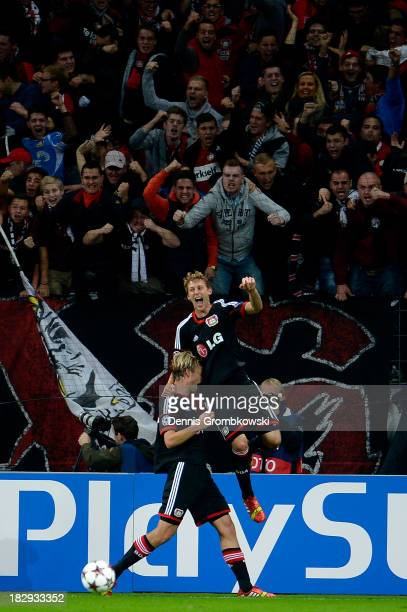 Simon Rolfes of Leverkusen is congratulated by teammate Stefan Kiessling after scoring the opening goal during the UEFA Champions League Group A...