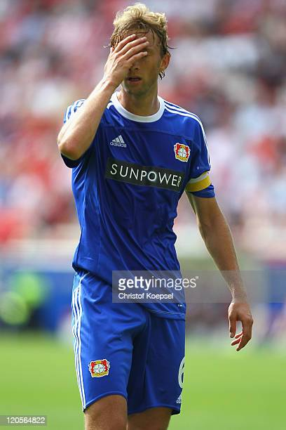 Simon Rolfes of Leverkusen looks dejected during the Bundesliga match between FSV Mainz 05 and Bayer 04 Leverkusen at Coface Arena on August 7 2011...