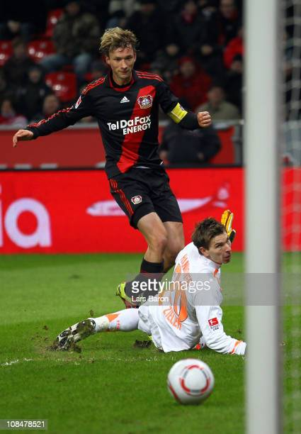 Simon Rolfes of Leverkusen scores his teams second goal past goalkeeper Ron Robert Ziemer of Hannover during the Bundesliga match between Bayer...