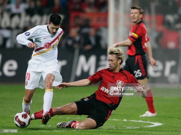 Simon Rolfes of Leverkusen tackles Eric Carriere of Lens during the UEFA Cup round of sixteen second leg match between Bayer Leverkusen and RC Lens...