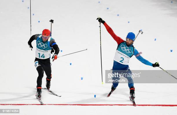 Simon Schempp of Germany and Martin Fourcade of France at the finish line during the Biathlon Men's 15km Mass Start on day nine of the PyeongChang...