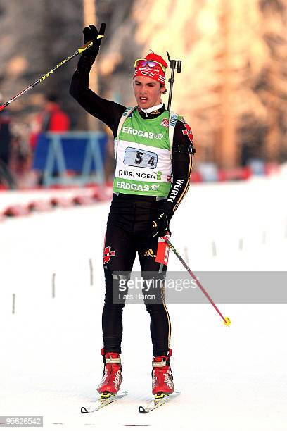 Simon Schempp of Germany celebrates after winning the third place during the Men's 4 x 7,5km Relay in the e.on Ruhrgas IBU Biathlon World Cup with...