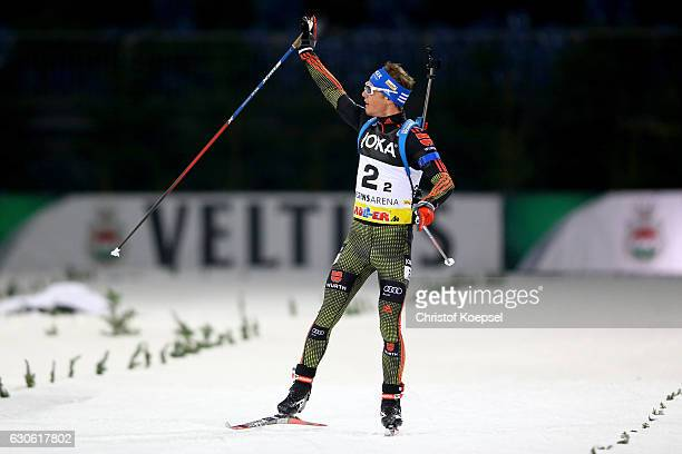 Simon Schempp of Germany celebrates winning the JOKA Biathlon World Team Challenge 2016 at Veltins-Arena on December 28, 2016 in Gelsenkirchen,...