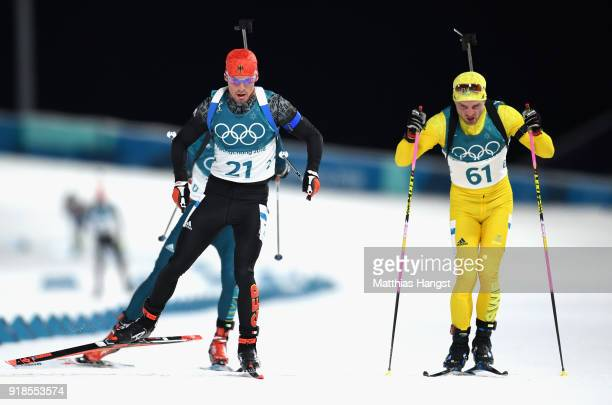 Simon Schempp of Germany finishes with Jesper Nelin of Sweden during the Men's 20km Individual Biathlon at Alpensia Biathlon Centre on February 15...
