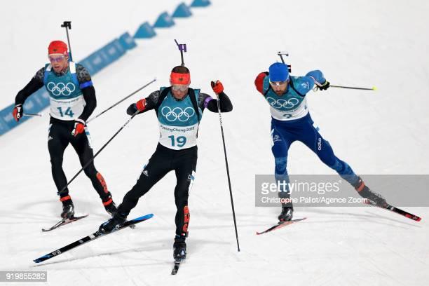 Simon Schempp of Germany Martin Fourcade of France in action during the Biathlon Men's 15km Mass Start at Alpensia Biathlon Centre on February 18...